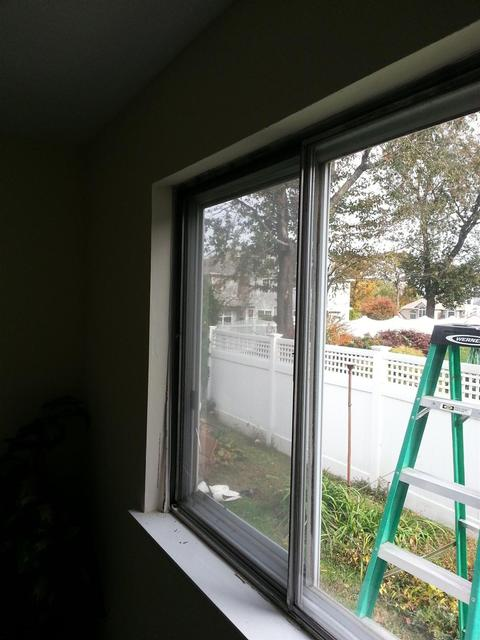 83:  We follow the same process as before. Flash, caulk, set, shim, screw, and flash again. Both windows are now in.