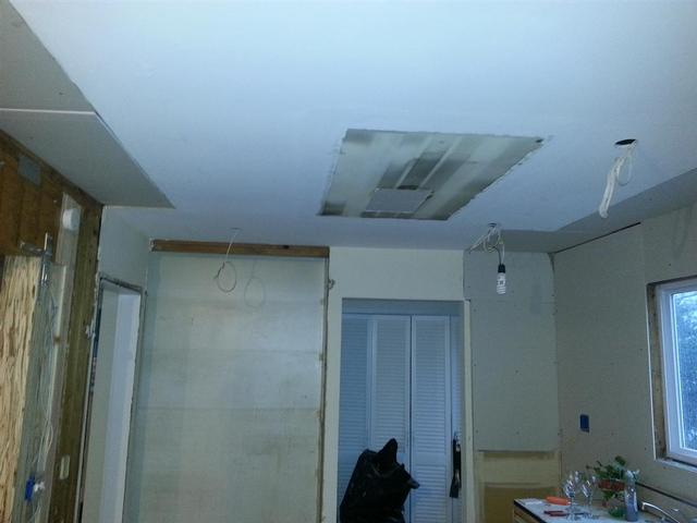 139:  We removed the old light fixture boxes and cut and patched rectangular sheetrock sections to  get to the joists.