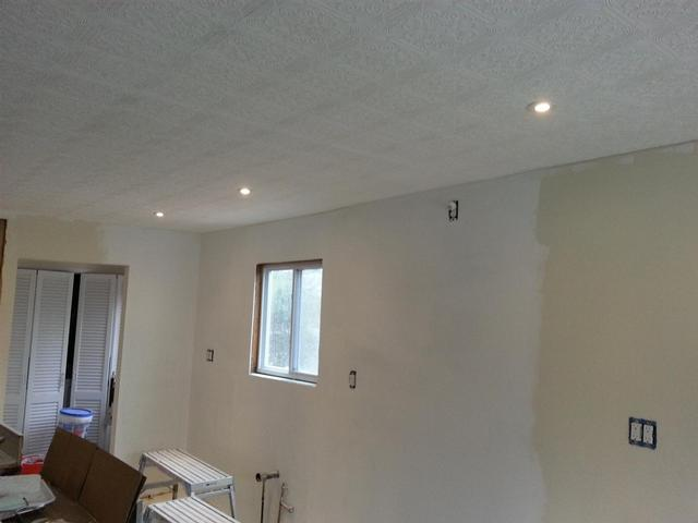 154: We put a quick coat of flat white on the textured ceiling, then installed the recessed LED lighting. We went with small 3