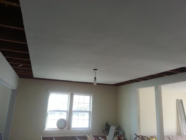 172: We trimmed back the sheetrock in the ceiling where the dropped tray ceiling will go.