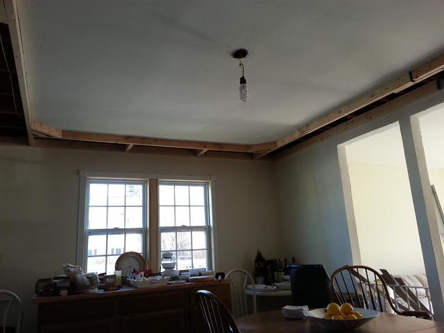 173: We framed out the tray ceiling with random leftover 2x4s.  We screwed them in toe nail style, and then nailed hurricane ties in a few locations to shore things up.   We also added insulation against the rim joist on the exterior wall.