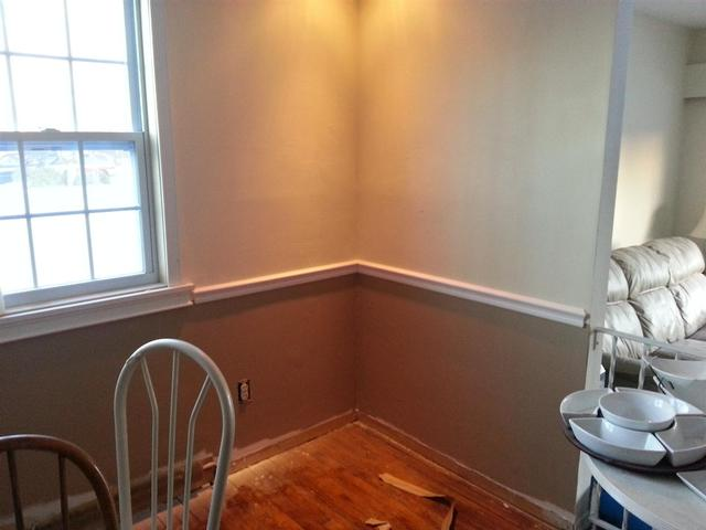 193: We painted the lower 1/3 of the wall with a darker flat, then added the chair rail.  Ill be replacing the radiator covers with new.