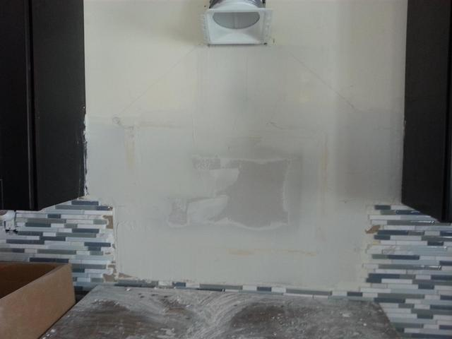 209: We had to patch a large secion of sheetrock after pulling off the tile.