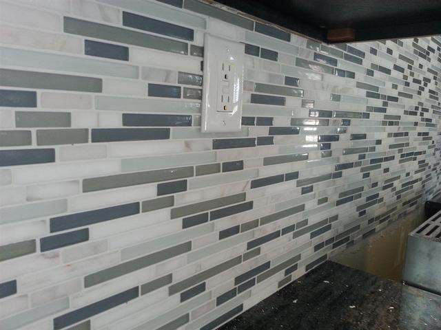 212: Finally sealed and grouted the backsplash and covered the outlets.  We went with snow white unsanded grout.