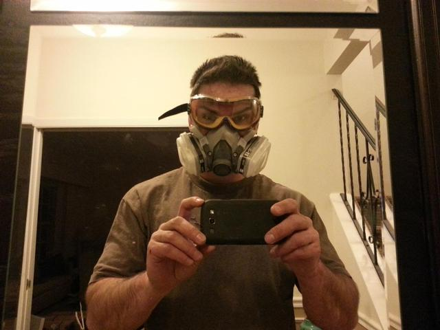 226: You dont want to take any chances breathing in the dust from the old tile and adhesive, so its a full respirator and goggles for me!