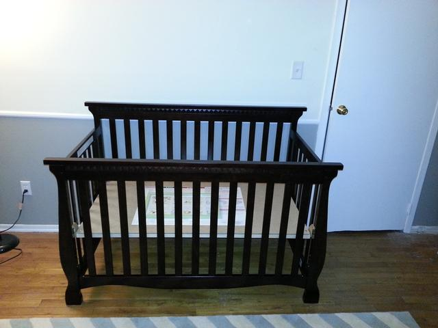 351: We assembled the crib.  It converts into a toddler bed with an open front, and after that you can convert it to a twin size bed as he grows.  Thanks to James and Amanda for the suggestion.